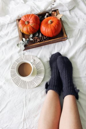 girl in socks with pumpkins